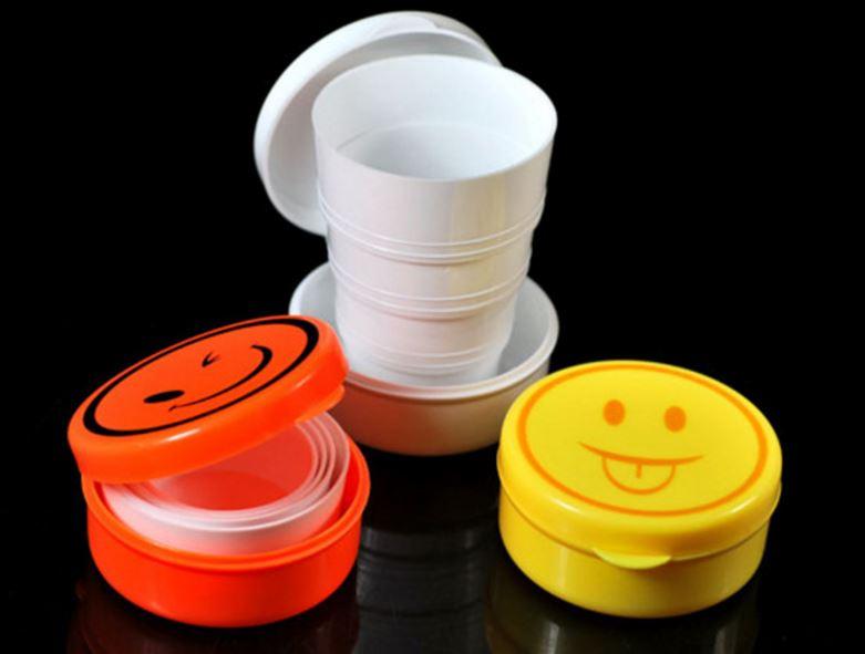 (隨機出貨)笑臉伸縮杯旅行杯壓縮杯子創意居家可愛折疊杯便攜式水杯 39元