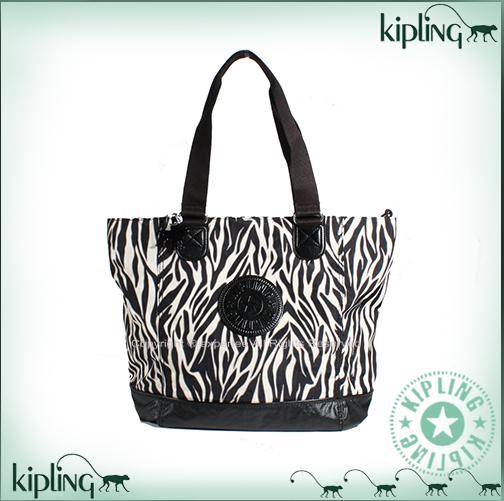 【騷包館】【Kipling】COMBO系列 漆皮底水餃肩背兩用購物包 斑馬 K-374-2272-048