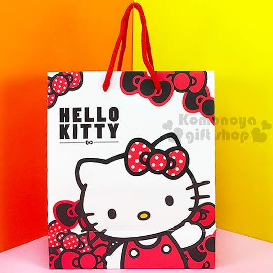 〔小禮堂〕Hello Kitty 直式提袋《白.舉單手.多紅蝴蝶結》送禮包裝最方便