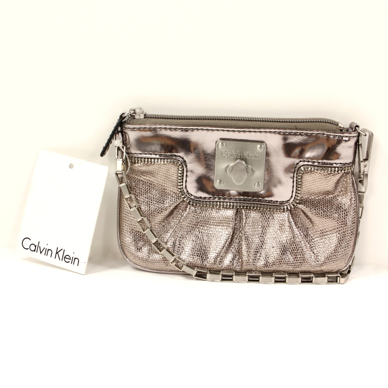 美國百分百【全新真品】Calvin Klein 包 手拿包 CK 女包 小包 宴會 鎖頭 化妝包 婚禮 銀色 限量 B431